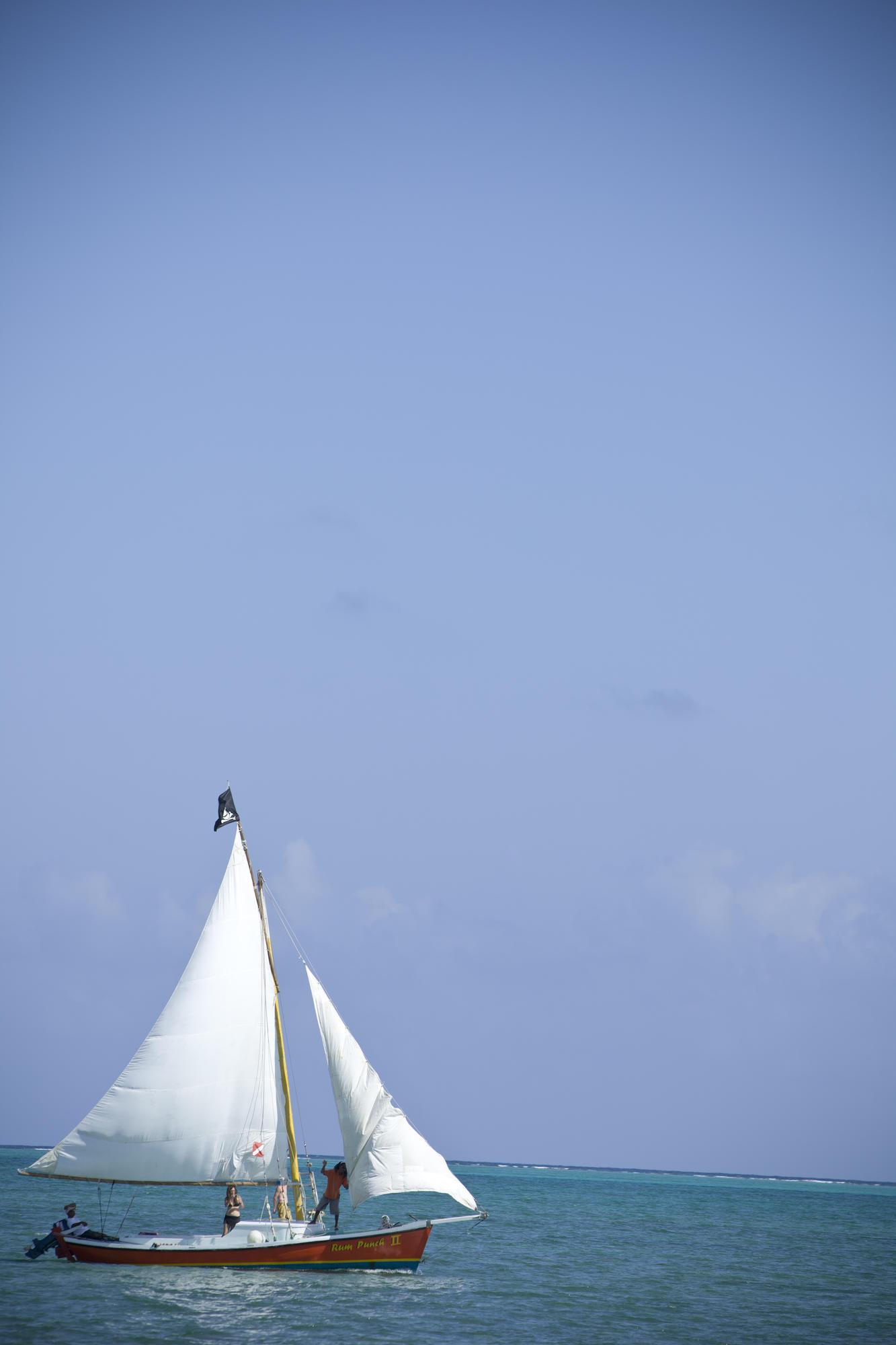 5 Reasons to Visit Belize During Winter  sailboat